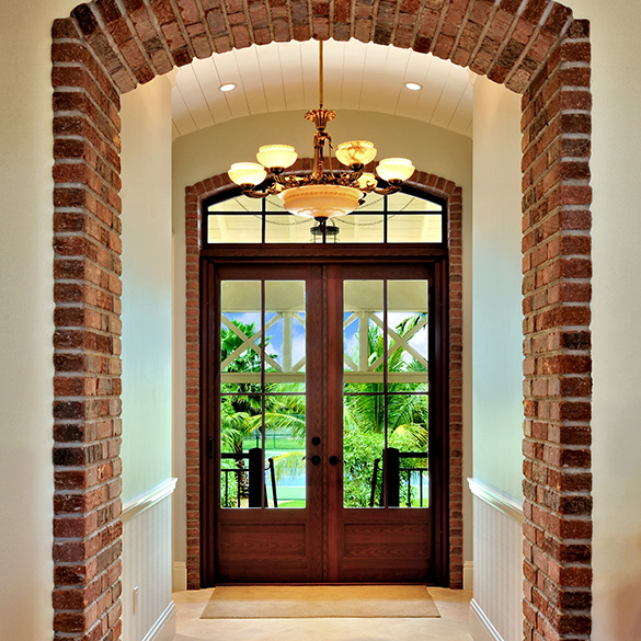 This Florida home was designed by D'Asign Source with CGI impact-resistant estate entrances.