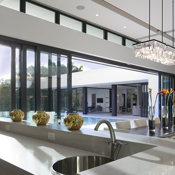 The Phil Kean Design Group's 2017 New American Home was built with large WinDoor sliding glass doors and impact windows.