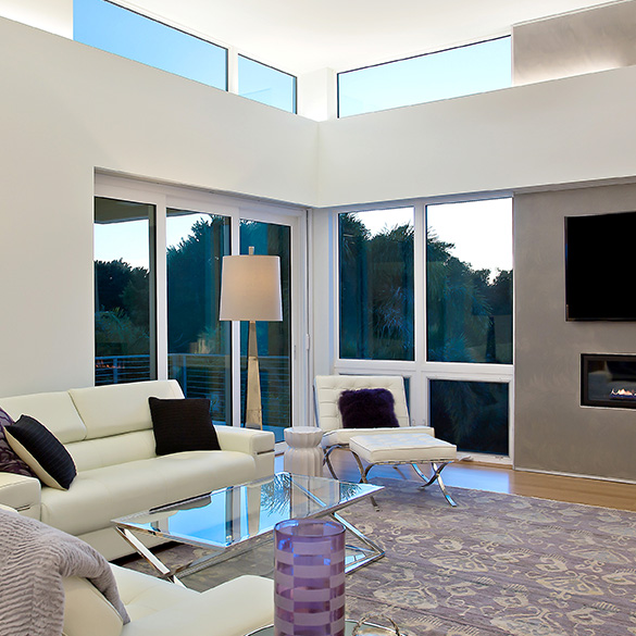 This Sarasota masterpiece was designed/built by Josh Wynne Construction with PGT EnergyVue windows and sliding glass doors.