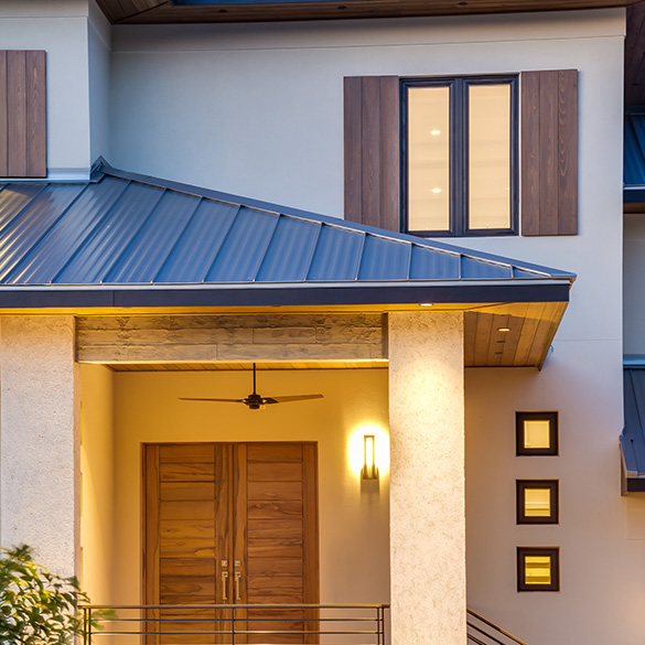This Florida residence was designed/built by Josh Wynne Construction with PGT WinGuard vinyl windows.