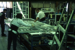 An older image shows employees at work in a warehouse.