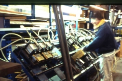A team member works with machinery.